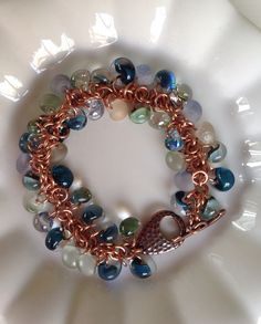 "Copper and Pebbles This is a ""shaggy loop"" bracelet adorned with hand made Boro lamp work glass beads. They remind me of pebbles at the bottom of a stream ;-)"