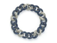 A sapphire and diamond bracelet, curb link design, with a repeating pattern of three links pavé set with round faceted sapphires weighing an estimated total of 7.97ct and one link of pavé set round brilliant-cut diamonds weighing an estimated total of 2.01ct, mounted in 18ct white gold, length approximately 18cm