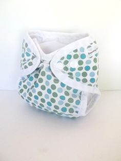 Newborn diaper cover shell with gussets and umbilical cord snap with wipeable inside