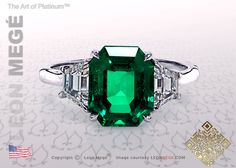 Three stone ring, featuring a 3.44 carat green emerald center stone.