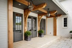 Gas lanterns add charm to this gorgeous entry way from Allard Ward Architects.