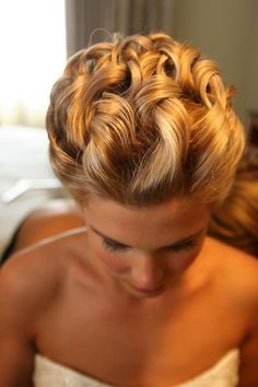 Highlighted textured curly blonde updo hairstyle