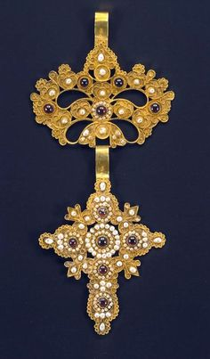 """Gold cross, part of a pectoral ornament. From the Ionian island of Corfu. Made of pierced gold leaf with an applied filigree decoration forming foliate """"cases"""" it is encrusted with gems and pearls. Similar crosses are also encountered on Patmos in the Dodecanese islands. 18th-19th c. unknown artist   Benaki Museum of Greek Civilization"""