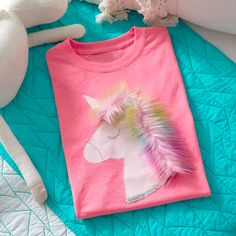 Applique a unicorn complete with a furry mane to a purchased T-shirt. Applique pattern included in instructions. #sewing #sewforkids #unicorn #applique #coatsandclarkmetallicthread