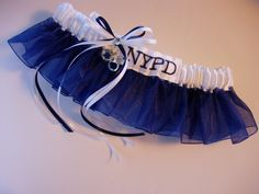 Police Officer wedding garter honoring the NYPD.  Silver handcuffs charm and embroidery personalization complete the design.  Organza and satin Style 3B from TheWeddingGarter.com