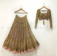 Stunning designer lehenga and blouse with full sleeves. Lehenga and blouse with hand bombardier sequence and zardosi work. Lehenga with pink color piping at boarder. Blouse with gold color ball latkans. Indian Bridal Outfits, Indian Designer Outfits, Dress Indian Style, Indian Dresses, Eid Dresses, Party Dresses, Indian Attire, Indian Wear, Indian Lehenga