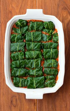We get a bunch of Collard Greens almost every week in our CSA box.  Love them and have always loved rolls made with Swiss Chard.  Not sure why I never that of this.  Collard Rolls in a Spicy Tomato Sauce