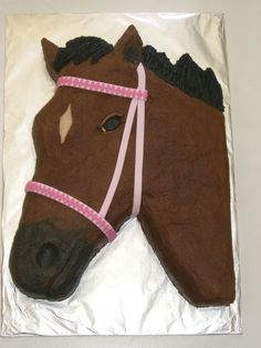Horse - This is for a little 6 year old girl! It is buttercream, with a fondant bridle. It took me a lot longer to do the pattern on the bridle than I expected!!
