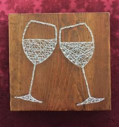 A new twist on string art! This is a 9 X 9 1/2 piece of rustic wood with toasting wine glasses made with silver nails and jewelry wire. This is a great gist for that wine lover or for a celebration gift.  My pieces are handmade and used with a variety of different wood, so they are truly one of a kind. @VinoPlease #VinoPlease