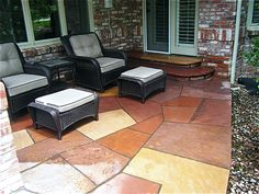 Flagstone - with grout could be a good option for a pathway that is easy to shovel. denverconcretemasonry.com