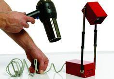 Ret en krøllet ledning ved at opvarme den med en føntørrer.