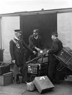 London North Western Railway staff at London, Euston station in 1907.  A splendidly uniformed passenger guard on the left is posed in conversation with two porters.
