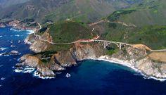 Bixby Creek Bridge hugs California's coast. Aerial photograph from Aerial America.