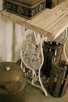 Vintage sewing machine table with old boxes and other vintage finds