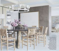 David Netto.  dining room.  rush chairs, raffia chairs, gray, beige, white, white chandelier, hamptons, Architectural Digest