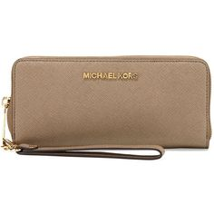 MICHAEL Michael Kors Jet Set Travel Continental Wallet ($158) ❤ liked on Polyvore featuring bags, wallets, dark dune, brown bag, saffiano leather zip around wallet, michael michael kors, michael michael kors bags and american bag