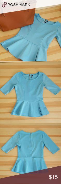 Lulus Blue Peplum Blouse Size Xsmall Lulus exclusive! Beautiful blue blouse with 3/4 sleeves! Pretty and very flattering peplum design! Works for multiple body types! In excellent condition with zero holes, tears, or stains! Super cute zipper at top of back for easy and convenient in and out! Size Xsmall. I have this item in lavender too in my closet! Let me know if you have any questions! Ships ASAP! Smoke free and pet free home! Lulu's Tops