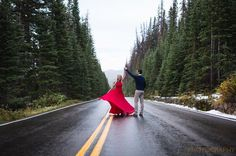 That red dress the evergreen trees and a little snow falling made for a fantastic engagement session in #RMNP with Dovile and Corbin. . . . . . . #engaged #engagementsession #engagementphotos #photography #rockymountainnationalpark #estesparkcolorado #estespark #colorado #bride #groom #theknot #theknotweddings #greenweddingshoes #stylemepretty #bridetobe #lovestory #bestengagementphotos