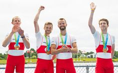 Members of Canada's men's lightweight coxless four, from left, Eric Woelfl, Nicolas Pratt, Brendan Hodge, and Maxwell Lattimer celebrate winning the gold medal at the 2015 Pan Am Games on the Royal Canadian Henley Rowing Course in St. Catharines, Ont., Wednesday, July 15, 2015.