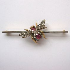 A LATE VICTORIAN RUBY AND DIAMOND BEE BAR BROOCH