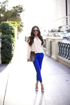 Royal blue pants + white long sleeve blouse + leopard print clutch