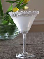 Coconut Cake Martini.  1 part Cake-Flavored Vodka 3 parts Coconut Water 1 tbsp Coco Lopez (optional and will add more calories!) Shake with ice Optional: Trace rim of martini glass with a finger-full of honey and dip into a plate of sweetened coconut for a pretty presentation.