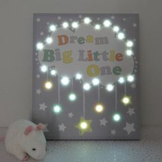 A gorgeous and unusual LED lit canvas for a childs bedroom or nursery.This canvas picture features 29 LED fairy lights which create a lovely effect when switched on. Hang it on a wall or place it on a shelf to add a soft light and a touch of magic to your childs bedroom or nursery. In fact, the 2 hour timer function makes it ideal as a children's night light. This would make a thoughful gift at a babyshower for a new baby or as a childs birthday or Christening present. The back of the…