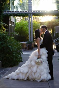 I adore how her bouquet is hanging at her side, like he's kissing her so well that she forgot to hold it up. Rowrrr!