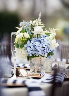 The combination of fresh blue hydrangeas and white flowers is so charming for an outdoor summer reception.