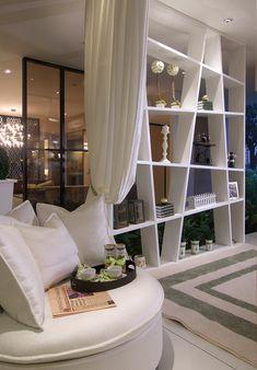 sofa seat with tray + windowed doors between rooms.