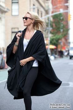 This cape and black leggings are Gotham City street style at its best.