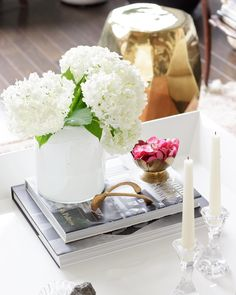 Living room coffee table styling with white hydrangeas