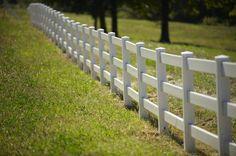 Rural white picket fence