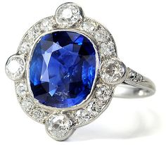 3 ct Burmese sapphire deco ring, surrounded by .75 tcw European cut diamond halo