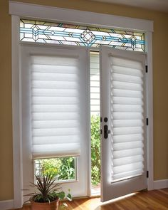 Nice roman shades for the doors to the balcony.