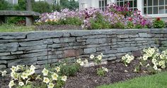 "PA Antique™ Dry Stack Wall  /// . Dig a footing. You need to start your wall 3"" - 6"" below grade so that it cannot be shifted at its base. 2. Break the Joints.  3. Give the wall batter. Retaining walls need to have a ceratain amount of pitchback - or batter - about 1"" back for every 12"" of height. This rule applies only to retaining walls, but accent walls also benefit aesthetically and, to a degree, structurally from this construction technique"