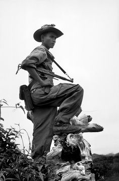Robert Capa - INDOCHINA. First Indo-Chinese War. Nam Dinh. A Vietnamese guard attached to the French Allied Command, at his post on a military base. May, 1954.