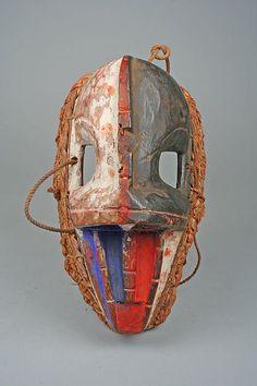 Mask Date: 19th–20th century Geography: Nigeria, Cross River region Culture: Igbo peoples Medium: Wood, string, pigment, fiber Dimensions: H. 8 3/8 x W. 4 5/8 x D. 4 1/8 in. (21.3 x 11.8 x 10.5 cm)