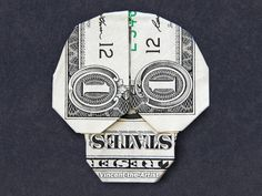 Hello,    Up for sale is a beautifully crafted Origami Skull. Its made from a brand new $1 US bill.    It makes a great novelty gift for that