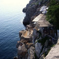 Buza Bar in Dubrovnik.  You can have a drink and then walk down the stairs for a quick dip in the sea!