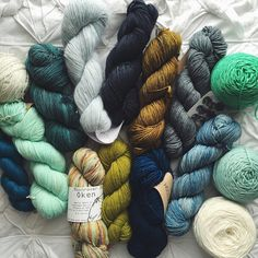 I decided not to take any projects with me on our trip so I could fully be present with my family but I left this little stack of yarn ready for me when I return 🙊 #juniperlemonadeafghan 💙🍋