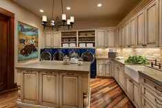 8X10 Laundry Room.  Like cabinets.  2 washers and 2 dryers on pedestals with cabinets similar to these above on one wall.  On opposite wall, sink, folding space and space for stand up freezer.  Pull out ironing board.