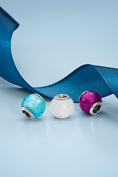 Add color and a harmonious look to your bracelet with these geometric beauties. Each charm has 70 hand-polished facets making it glisten beautifully as it catches the light. Soon in stores! #PANDORA #PANDORAcharm