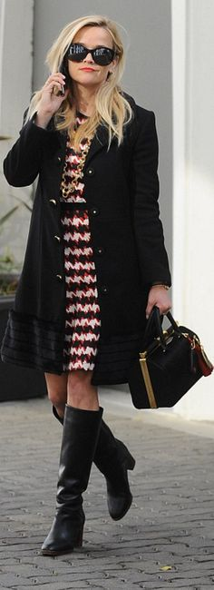 Who made  Reese Witherspoon's black coat, red key chain, handbag, white print dress, and key chains?