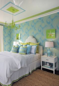 I would do this in a teen or kid's room in a heartbeat.  It's SO cheerful, that lime and turquoise with huge doses of fresh white, and look at the molding and ceiling design and chandelier, and well, everything!  Cheerful!