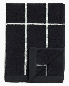 A hand towel made of thick cotton terrycloth featuring Armi Ratia's Tiiliskivi pattern. Material: cotton terry Colour: black, white Size: Hand 50 x 100 cm x