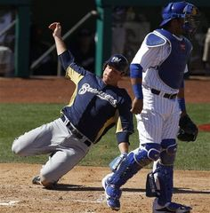 Milwaukee Brewers' Mat Gamel, left, scores past Chicago Cubs catcher Geovany Soto