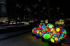 Stroll through the garden at the entrance of Burj Khalifa and admire the colourful sculptures which at night are backlit for your viewing pleasure. — at Downtown Dubai - The Centre of Now.