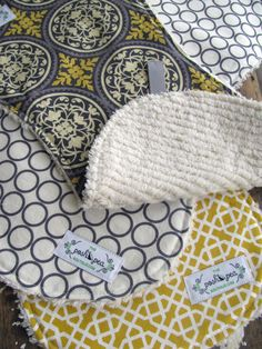 burp cloths - geo gold, grey scrollwork & grey circles  How old is this baby? Like 80? YUCK!