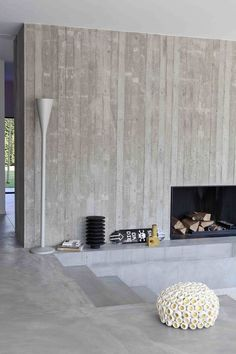 vertical board-formed concrete at minimalist fireplace // Hart Concrete Design: Concrete Fireplace, Concrete Houses, Modern Fireplace, Fireplace Wall, Living Room With Fireplace, Fireplace Surrounds, Fireplace Design, Minimalist Fireplace, Off Center Fireplace